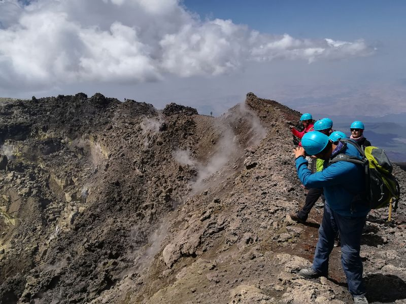 Hikers on the summit of Etna volcano