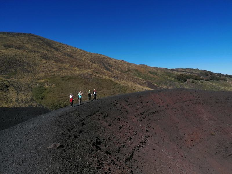 Hikers on the edge of a volcano crater