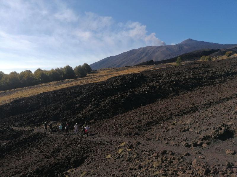 Hikers walking old lava flow